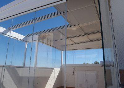 Techo Movil y Cortina de Cristal en terraza atico